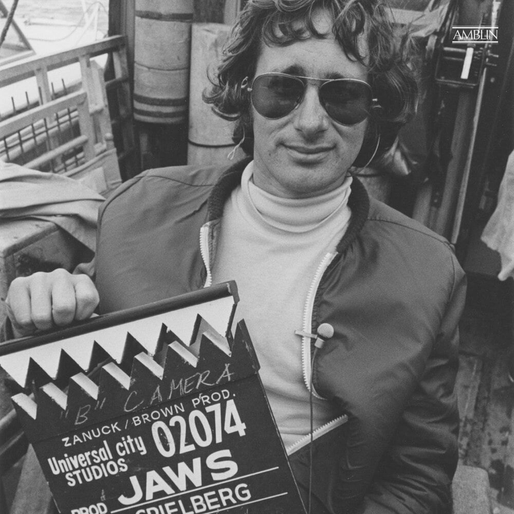 On location in 1974, at sea off of Martha's Vineyard, holding the cleverly and aptly modified slate for his breakthrough blockbuster, Jaws.