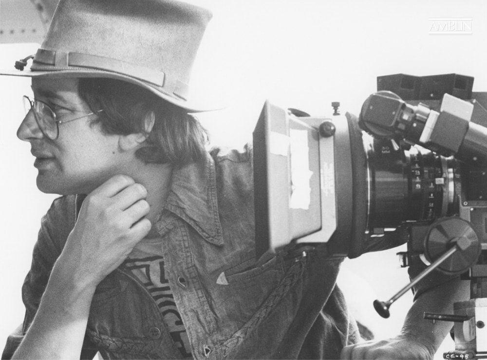 Spielberg sits alongside the camera, studying a scene playing out before him on Close Encounters of the Third Kind.