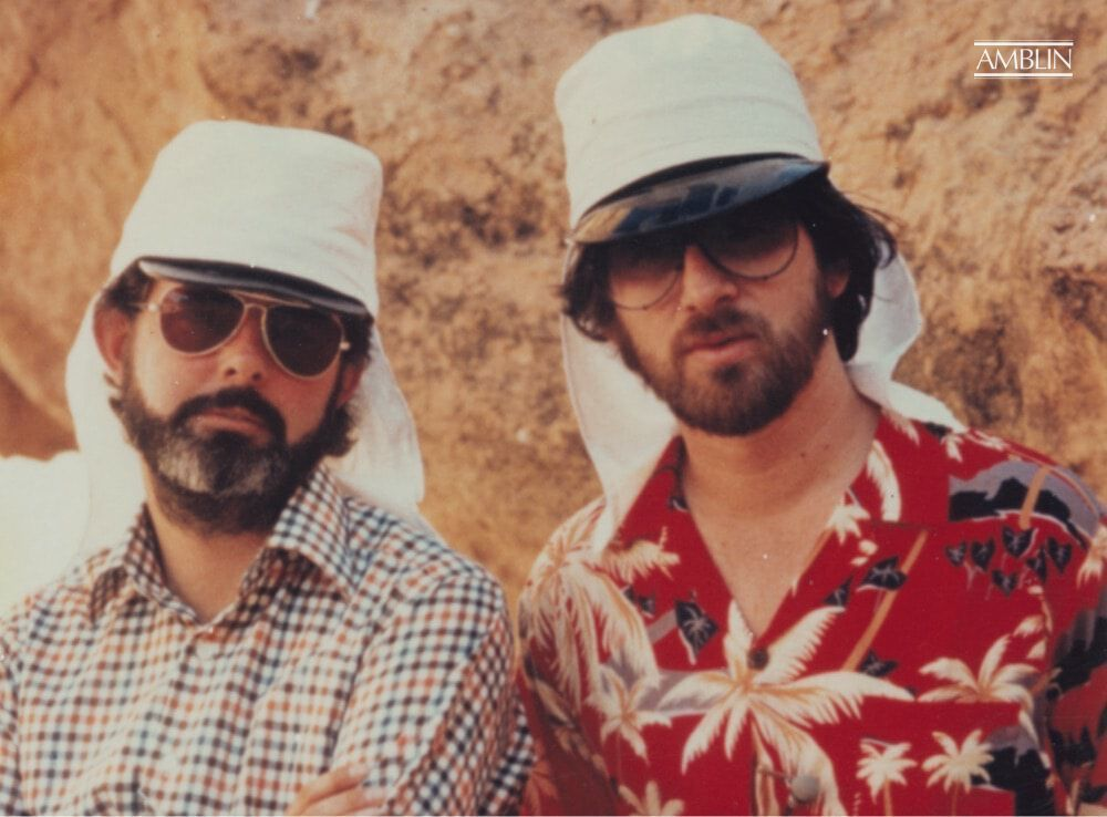 Hollywood's reigning visionaries, George Lucas (L) and Steven Spielberg (R), crazy creative from the heat of the Tunisian desert shoot on Raiders of the Lost Ark.