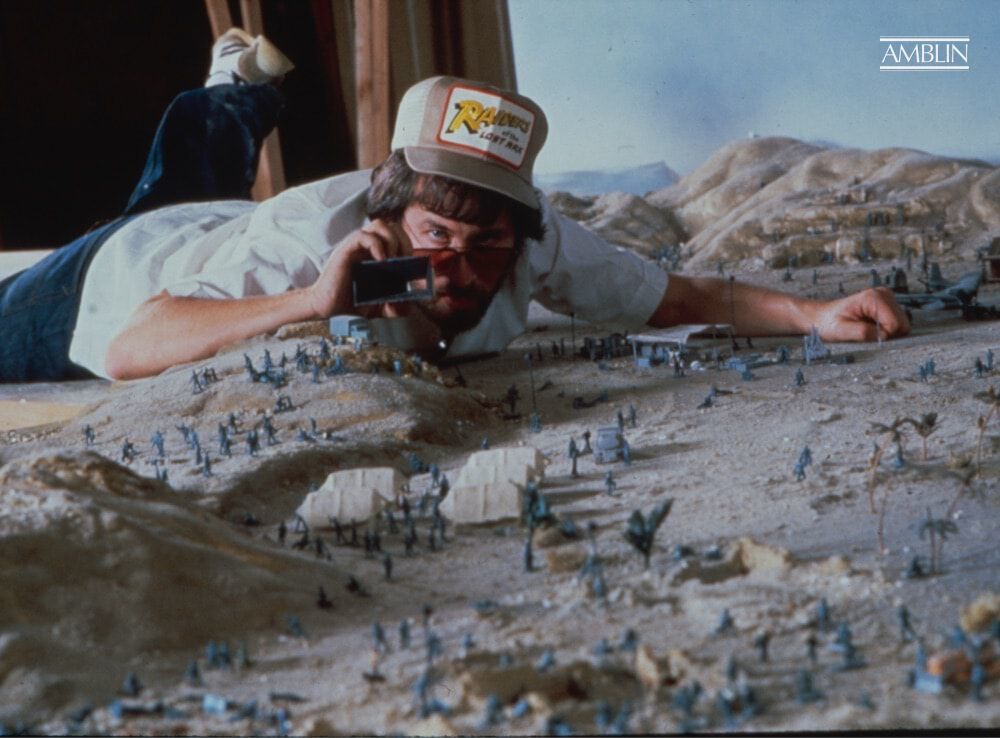A huge location shoot is all about getting the tiny details right. Spielberg pre-plans his shot concepts using a miniature layout and a widescreen eyepiece for framing on Raiders of the Lost Ark.