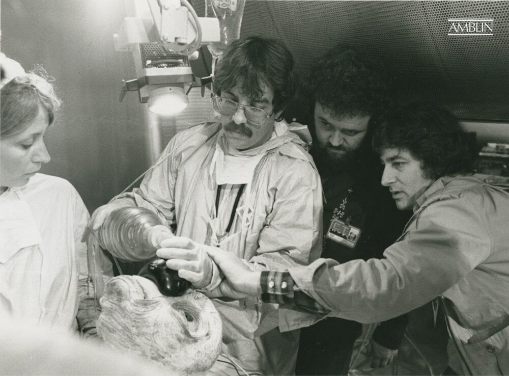 """You've gotta save him!"" Spielberg (along with director of photography Allen Daviau) setting up a shot with actors playing NASA scientists in the make-shift medical lab at the end of E.T. The Extra-Terrestrial."