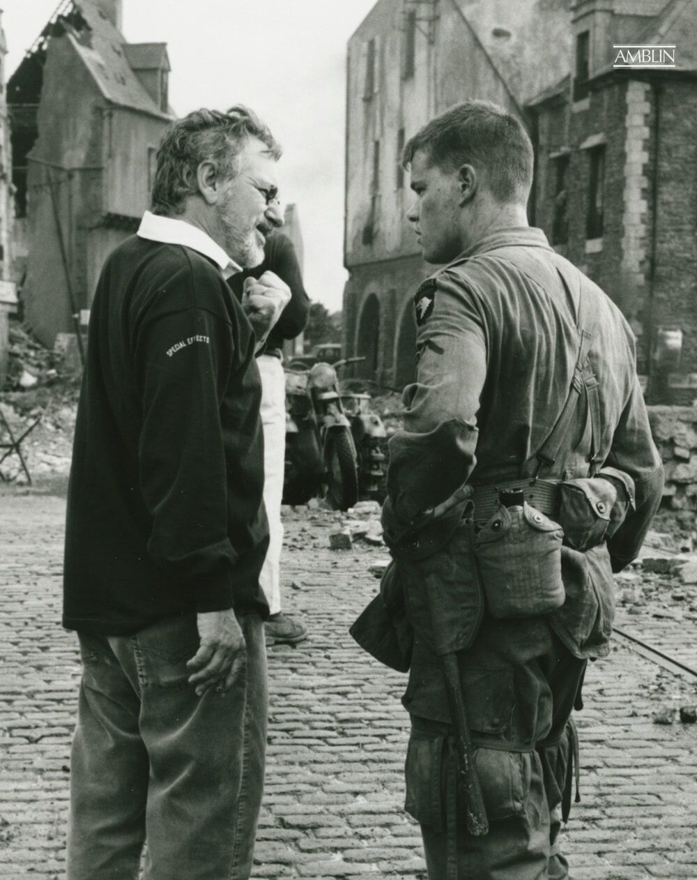 Directing Private Ryan (Matt Damon) on the fully constructed city of Ramelle (a fictitious location), the site of the final battle in the film.