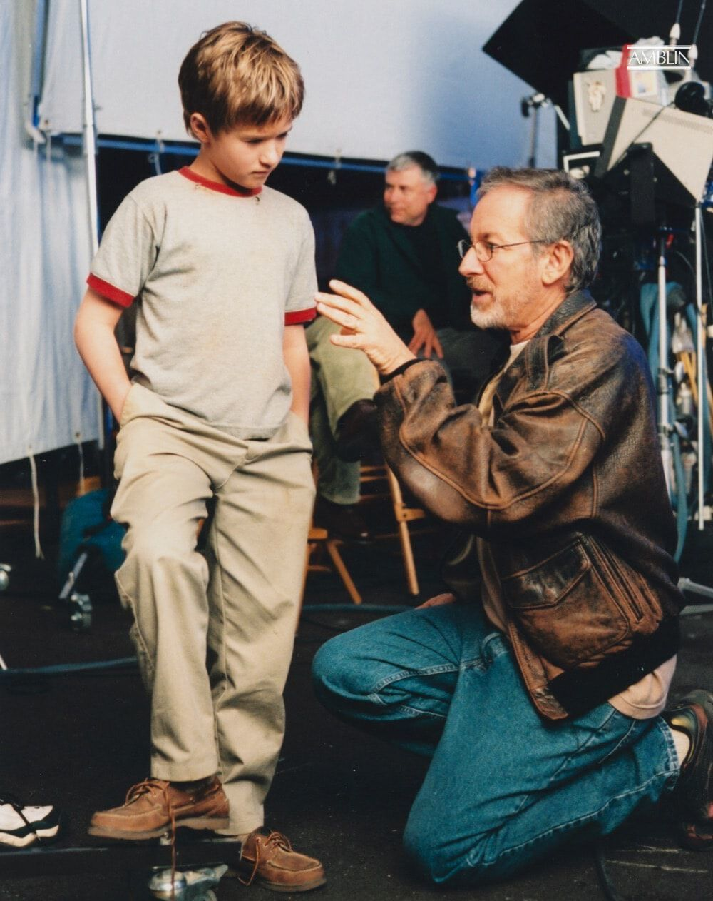 A young Haley Joel Osment, who plays the robot boy David, listens intently to his director's ideas in production on A.I. Artificial Intelligence.