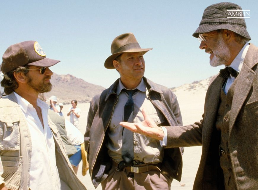 Working out the ins-and-outs of a key action setpiece with his Indiana Jones and the Last Crusade stars Harrison Ford and Sean Connery.