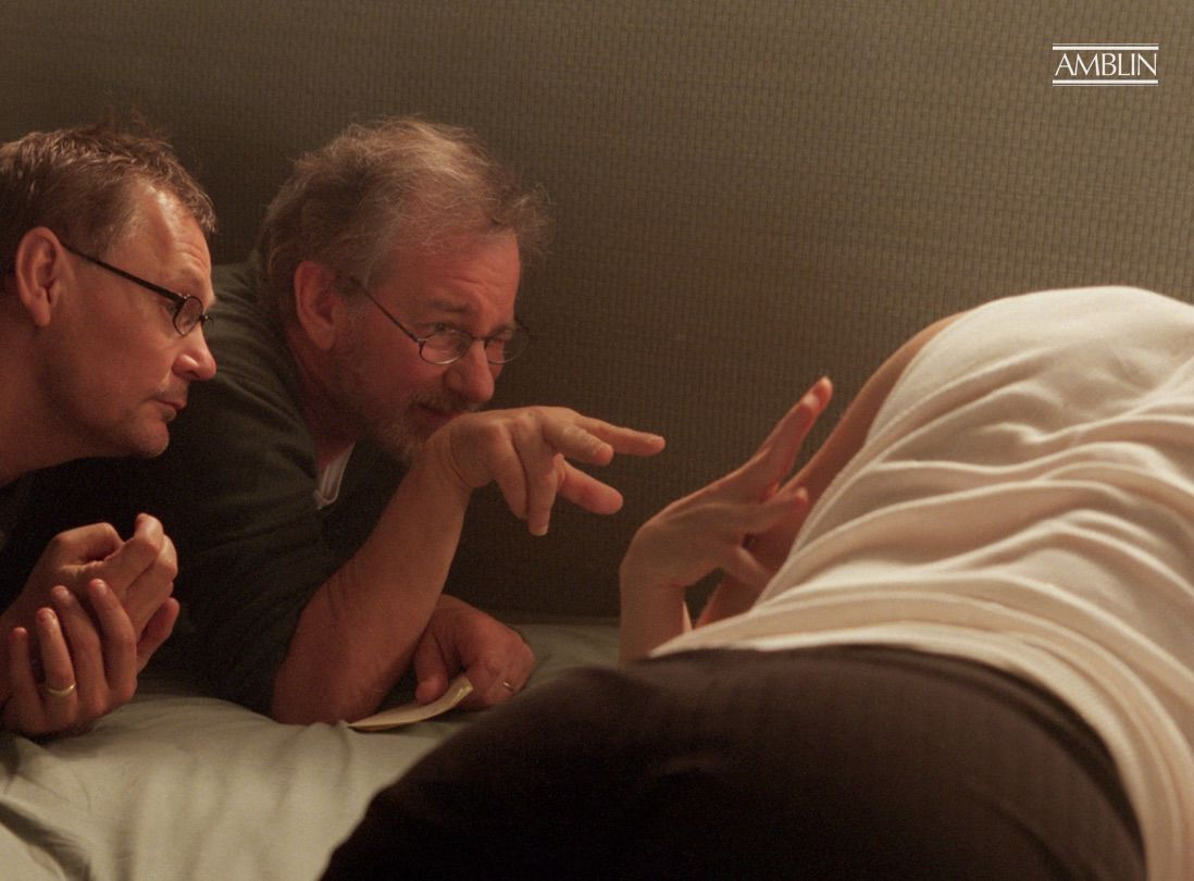 Scoping out a shot of a potentially ill-fated affair in Minority Report with director of photography Janusz Kaminski.