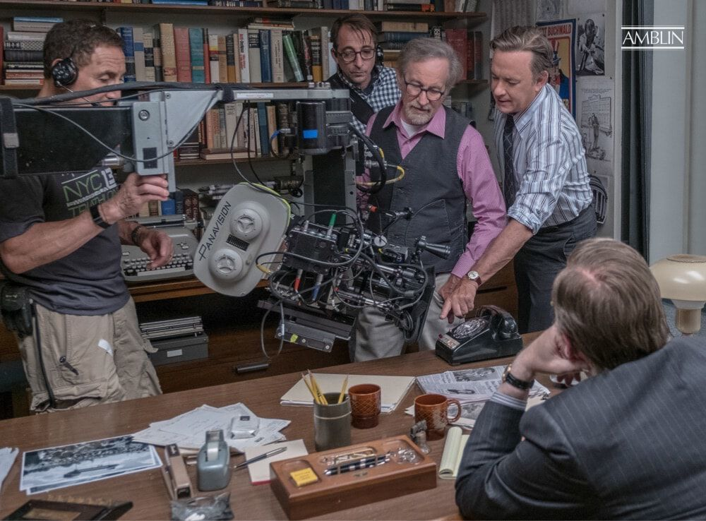 Discussing a shot with actor Tom Hanks, as legendary news editor Ben Bradlee, in The Post.