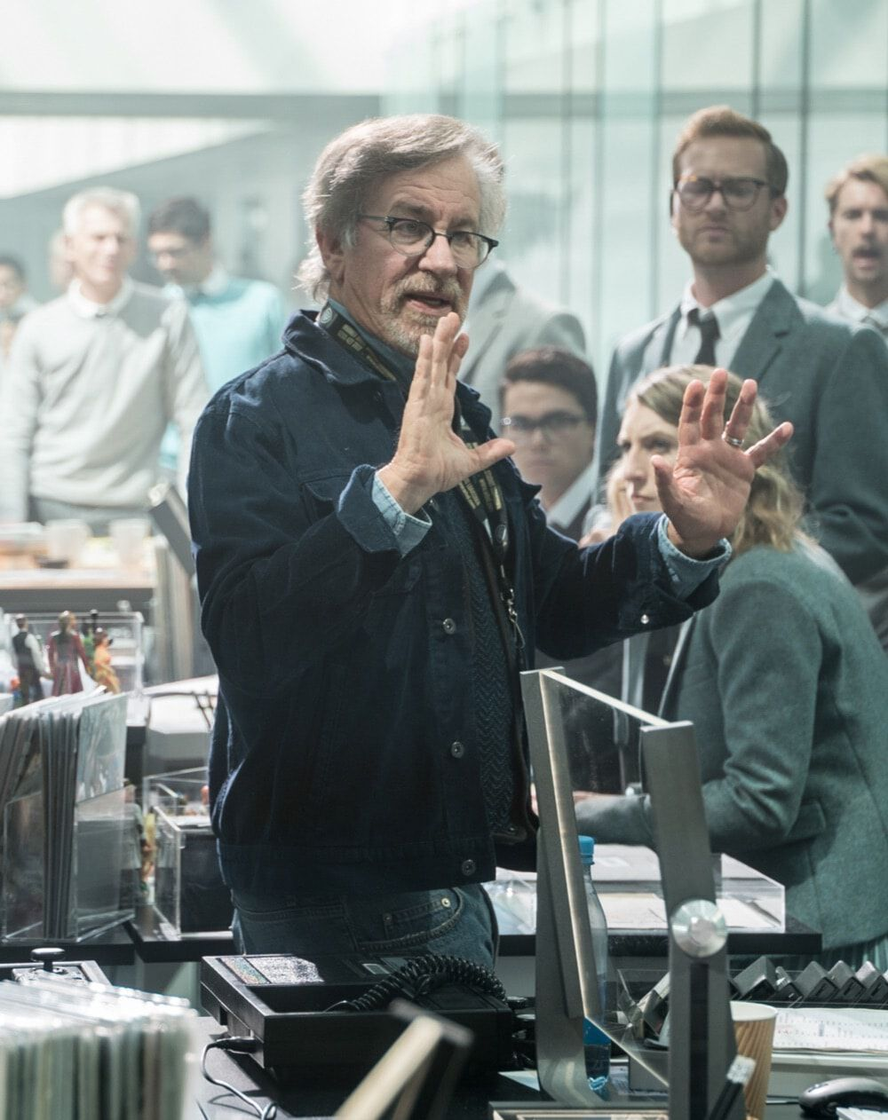 Spielberg describes a scene to his large cast of players in the offices of the OASIS Oologists in Ready Player One.